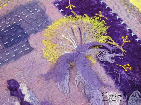 Creative sewing in shades of purple: Dandelion emerges