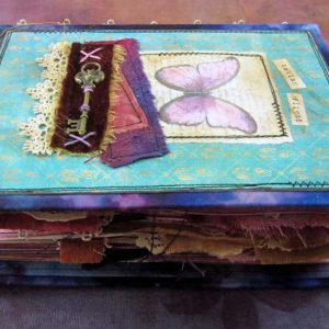 How to make a Handmade Journal with the Stitches Hidden in the Spine